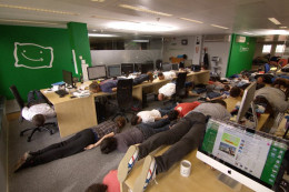 What is Planking?  An office of people planking at work.