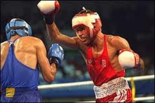 Oscar De La Hoya won a gold medal in the 1992 Olympics. He also won titles in 6 divisions as a pro fighter.