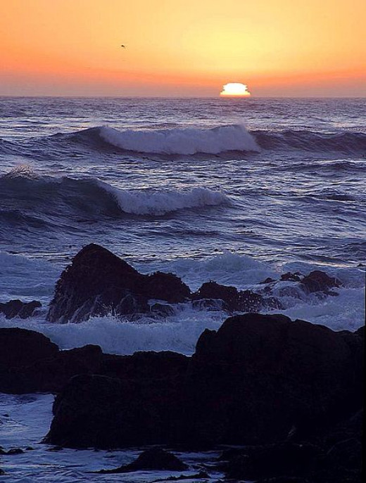 sunset over the ocean by Jon Sullivan
