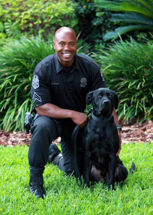 "Tampa police corporal K. Doan and his police service animal, partner ""Kilo"", train, work, and reside together. When on-duty, ""Kilo"" dons an official police badge affixed to outer police garment, typically a light sweater or nylon-fabricated harness."