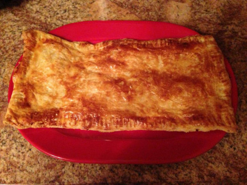 Freshly baked thin pastry with farmer cheese and apple filling in rectangular shape