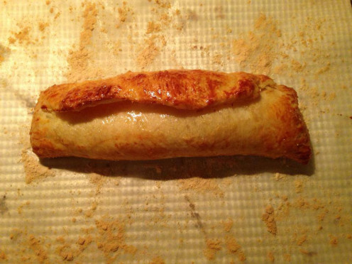 Freshly baked pastry roll with farmer cheese and apple filling