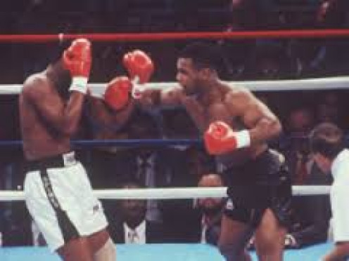 Iron Mike Tyson destroys the undefeated Michael Spinks in 91 seconds.  Tyson was a force of nature in the 1980's.