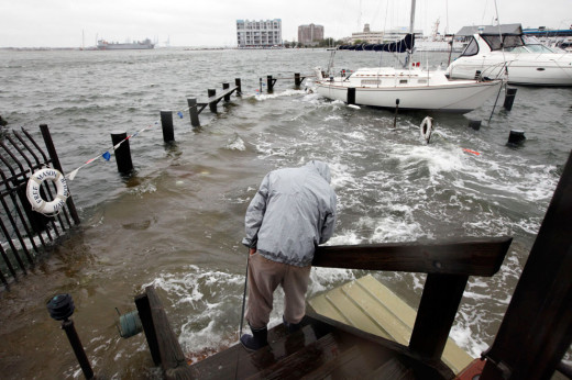 A man trying to recover his boat after Hurricane Sandy hit Northhampton, New York, 2012.