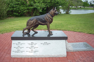 Law Enforcement Officers Memorial site in Tropical Park, Miami, Fla., is the site of this bronze statue of a police service dog. On the side wall is an etched list of police K-9s slain in Dade County, Fla.