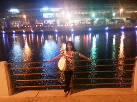 Inside a mall in Amwaj Island. behind me is a lagoon at the center of the floating mall.
