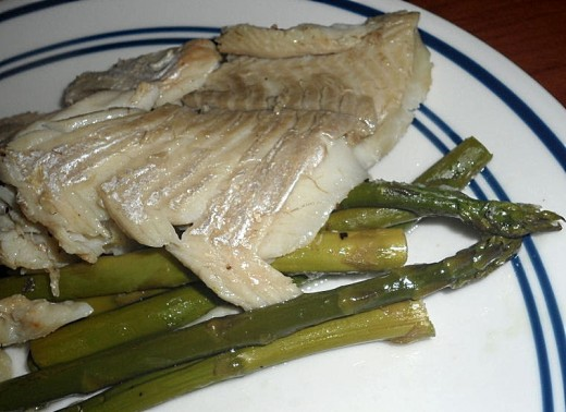 Baked fish fillet with asparagus - very delicate flavors that can be ruined by a sauce or marinade