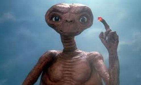 E.T. was directed by Stephen Spielberg and it was about an Alien living on earth with a family. This movie was a great family movie so, there was no shortage of people watching this one at the theater.