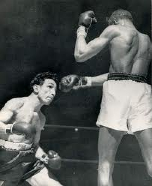 Sandy Saddler knocked out Willie Pep in four rounds to take the featherweight championship in 1948.