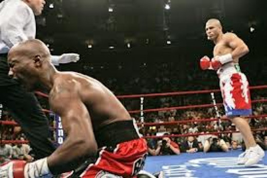 Miguel Cotto scores a knockout victory over Zab Judah at Madison Square Garden in New York in a give and take war.