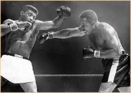 Archie Moore, seen here fighting Floyd Patterson, refereed many wrestling matches. Moore holds the record for the most knockouts with 145.