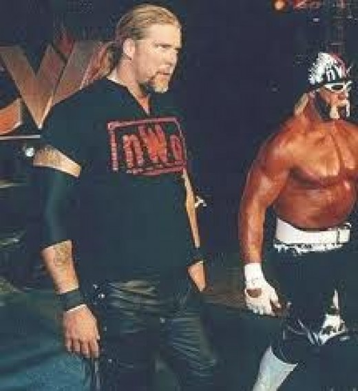 Kevin Nash, seen here with Hollywood Hogan, was part of the NWO red. He is a very big man to say the least.