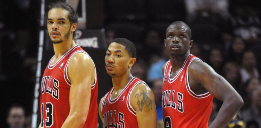 Joakim Noah, Derrick Rose and Luol Deng
