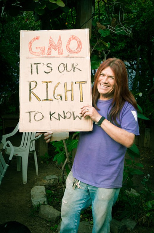 A protester in San Francisco, California, advocates for the labeling of GMO constituents in foods.