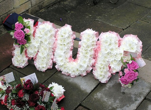 A floral arrangement at a funeral for a mother in England.