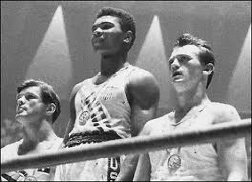 Muhammad Ali, seen here receiving the Gold Medal in the Olympics, was known to play to the crowd during his ring walks.