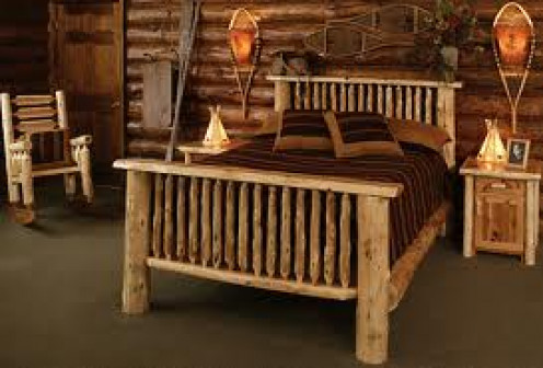 When decorating a log cabin be sure and have wooden furniture because it will complete the look.
