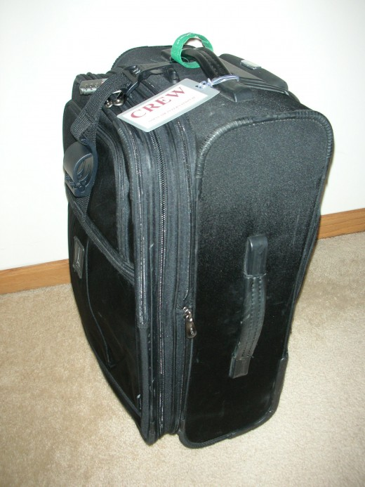 "My 22"" travelpro with expandible gusset zipped closed."