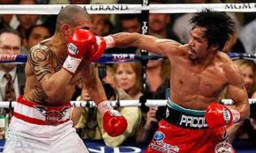 Manny Pacquiao lands a right hook on Miguel Cotto on his way to scoring a 12th round knockout.