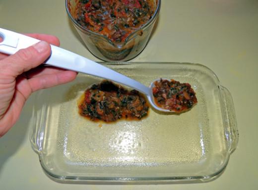 put a light layer of sauce on bottom of casserole