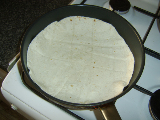 Heating the first tortilla wrap