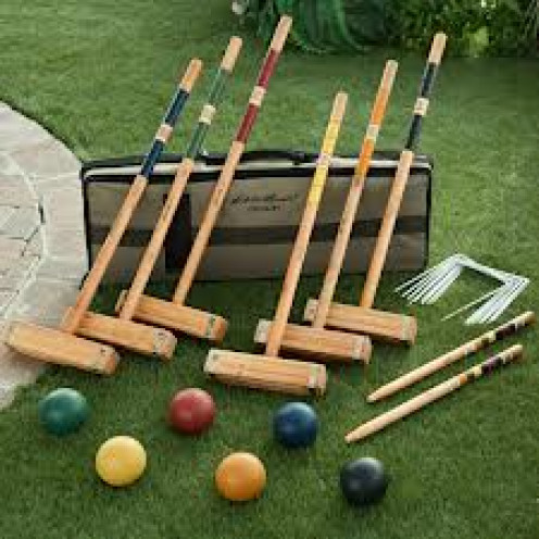 Croquet is similar to Golf but instead of hitting the ball into a hole you hit a larger ball through a looped over section on the ground.