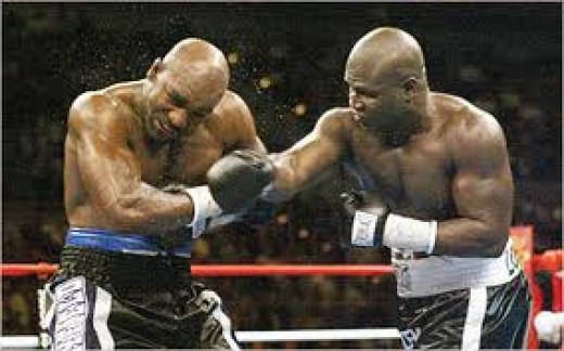 James Toney lands a counter right on Evander Holyfield en route to an easy knockout win during his foray into the heavyweight division.