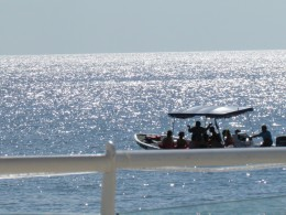 Boats arrive daily to take scuba divers to various destinations for their underwater adventure.