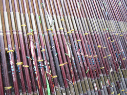 Fishing poles stacked up at the tackle store ready for purchase.