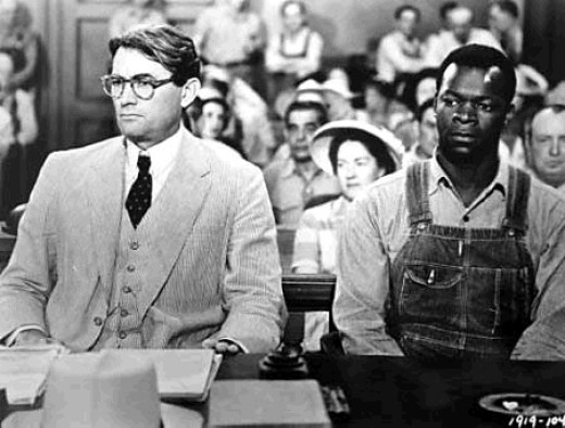 Screenshot from the film To Kill a Mockingbird (1962) with Gregory Peck as Atticus and Brock Peters as Tom Robinson