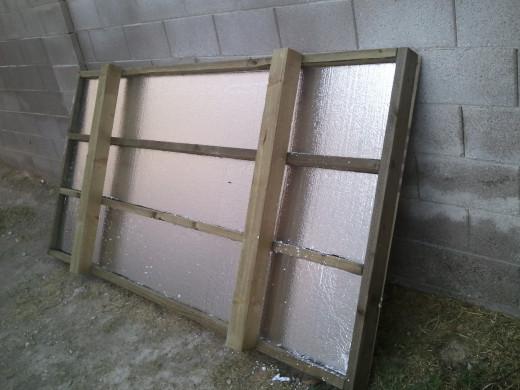 Styrofoam insulation in position under plywood floor sheathing.