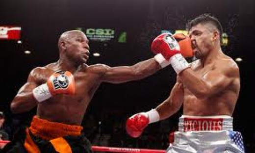 Floyd Mayweather knocks out Victor Ortiz in a bout in which Ortiz wanted to foul more than to fight.