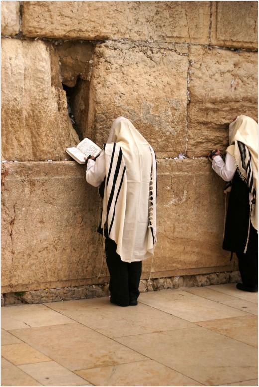Jews praying at the wailing wall in Jerusalem.