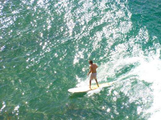 Surfer at Kalihiwai Beach, Kaua'i