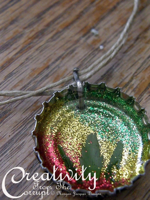 Make your bottle cap necklace look interesting not boring.
