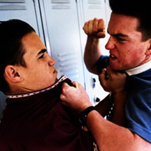 Two teenagers fighting. Anger is the basic and the most prominent negative value of a human being