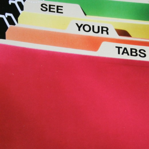 Color coded hanging files that hang lower to show your file folder headings