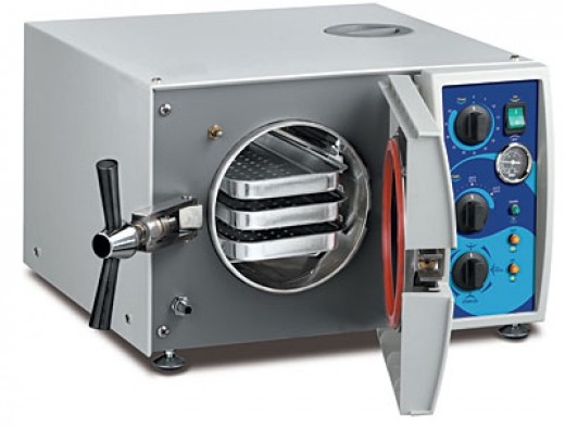 The autoclave sterilizes tattoo equipment to medical standards.