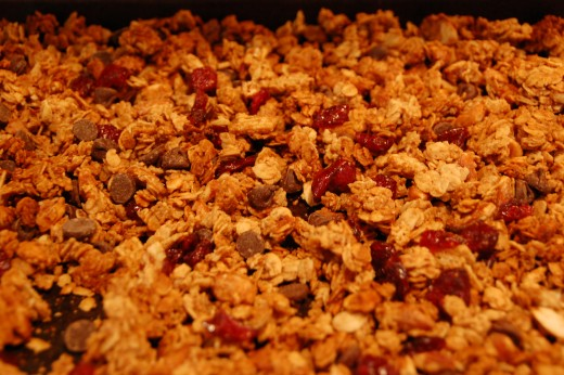 After allowing the baked granola to cool, at least one half hour or hour, you can add the dried cranberries and chocolate chips, the chips will get melty if it's too warm