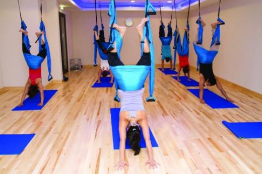 Look up if there are any classes in your area that teach how to usean aerial yoga swing.