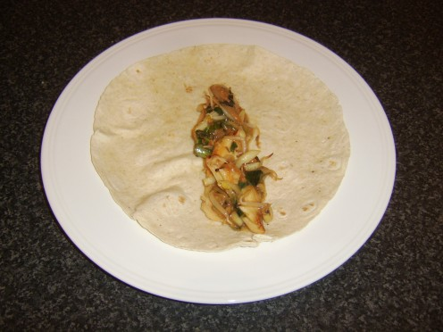 Leftover turkey breast and mixed vegetables are stir fried in Peking lemon sauce and incorporated in a tortilla wrap