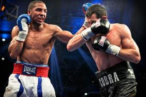 Andre Ward attacks Carl Froch in defense of his 168 pound championship in New Jersey. Ward won a Gold medal in the 2004 Olympics.