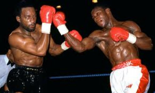 Nigel Benn and Chris Eubank battle it out in their super middleweight title bout. The two fought three different times.