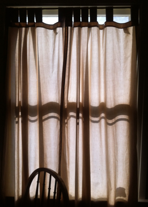 Curtains completely covering a large window.