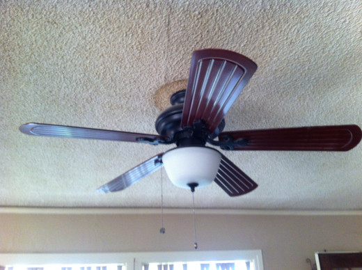 A ceiling fan in the living room of my house.