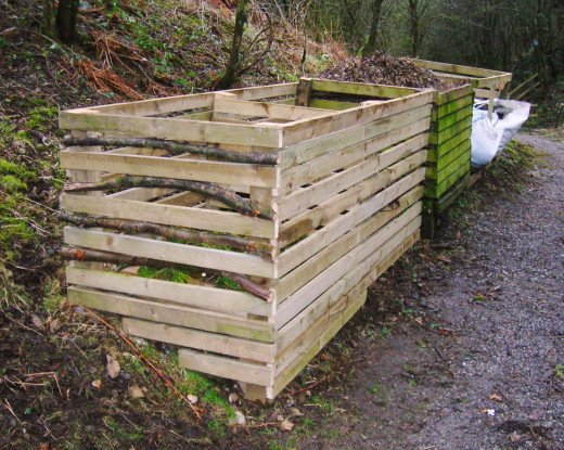 Compost bins created using slats of timber.