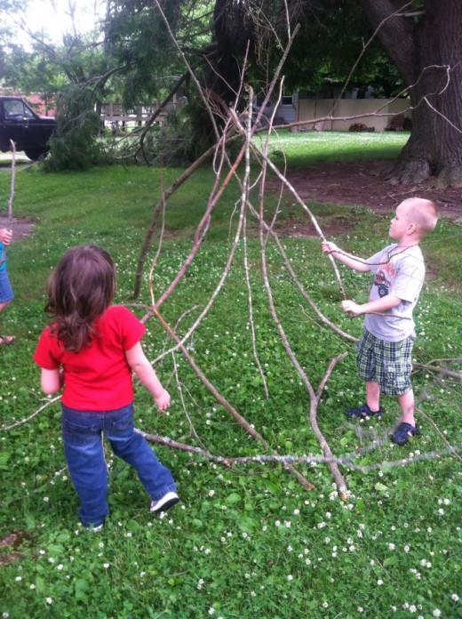 Maddox and Haley begin the frame work of their tepee.