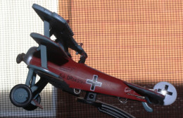 A PHOTO OF A MODEL OF THE RED BARON'S FOKKER TRIPLANE.