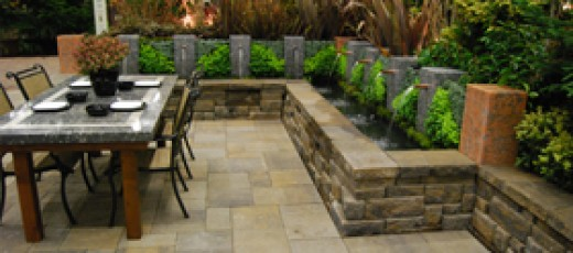 Outdoor living space for entertaining. Retaining wall with water elements.