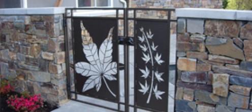 Designer leaf gate for retaining wall.